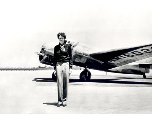 Amelia Earhart standing in front of the Lockheed Electra in which she disappeared in July 1937. Born in Atchison, Kansas in 1897, Amelia Earhart did not begin flying until after her move to California in 1920. After taking lessons from aviation pioneer Neta Snook in a Curtiss Jenny, Earhart set out to break flying records, breaking the women altitude records in 1922. Earhart continually promoted women in aviation and in 1928 was invited to be the first women to fly across the Atlantic. Accompanying pilots Wilmer Stultz and Louis Gordon as a passenger on the Fokker Friendship, Earhart became an international celebrity after the completion of the flight. In May 1932 Earhart became the first woman to fly solo across in the Atlantic. In 1935 she completed the first solo flight from Hawaii to California. In the meantime Earhart continued to promote aviation and helped found the group, the Ninety-Nines, an organization dedicated to female aviators. On June 1, 1937, Earhart and navigator, Fred Noonan, left Miami, Florida on an around the world flight. Earhart, Noonan and their Lockheed Electra disappeared after a stop in Lae, New Guinea on June 29, 1937. Earhart had only 7,000 miles of her trip remaining when she disappeared. While a great deal of mystery surrounds the disappearance of Amelia Earhart, her contributions to aviation and womens issues have inspired people over 80 years.